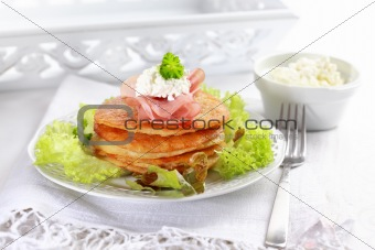 Small potato pancakes with salad