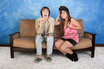Annoyed Young Woman With Loud Boy