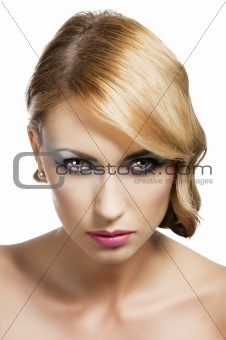 blond vintage girl portrait, she has an actractive eyes