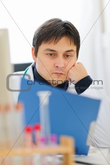 Medical doctor working with documents