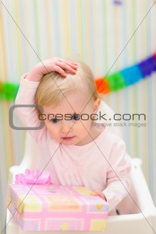 Portrait of embarrassed baby celebrating first birthday