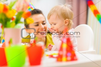 Baby and mother partying first birthday