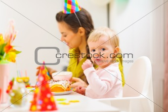 First birthday celebration party with mother and baby