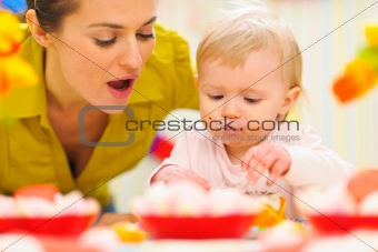 Baby celebrating first birthday with mom