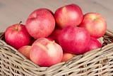 red apples in basket on the table