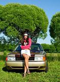 Beautiful girl ready for washing a retro car