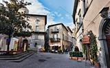Orvieto, Umbria, Italy, narrow street with small shops