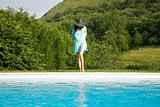 blue dress woman on pool border