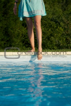 feet on swimming pool border