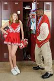 Cheerleader and baseball player by lockers