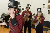 Girl on cellphone in band practice