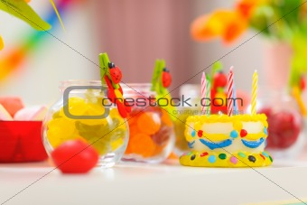 Closeup on table decorated for baby birthday party