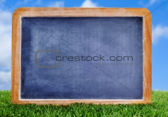 blank blackboard on the grass