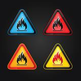 Hazard warning triangle highly flammable warning set symbols on a metal surface