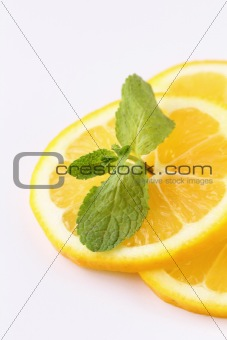 three slices of lemon with mint leaf