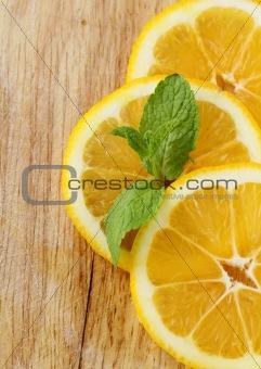 three slices of lemon with mint leaf