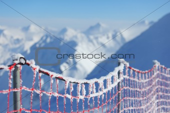Hoarfrost on protective net in mountains