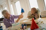 Grandmother with party hat for grandson