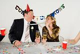 Couple with party blowers