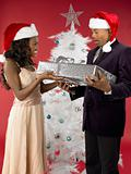 Woman giving man present