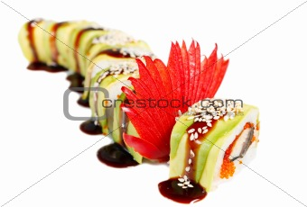 Sushi Roll with avocado, eel, tobiko caviar, sauce and sesame