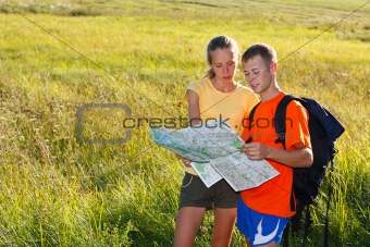 Young couple  traveler read the map