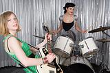 Female guitarist and drummer