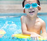 happy asian kid in Swimming Pool