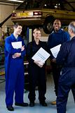 Apprentice mechanics and tutor