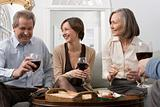 Woman and parents having wine