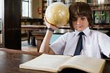 Boy reading and holding football