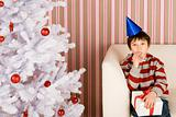 Boy blowing party horn