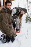 Young couple with snowshoes