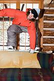 Man on sofa with snowboard