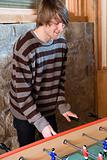 Young man playing table football