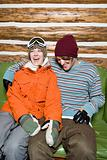 Snowboarder couple laughing