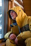 Snowboarder looking out of window