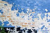 blue paint peeling brick wall