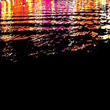 Citylight Reflections On Water Surface