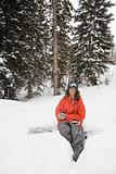 Snowboarder sitting on board
