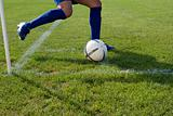 Footballer taking a corner kick