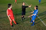 Referee giving footballer red card