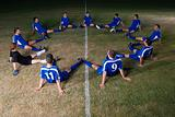 Football team stretching leg