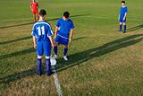 Footballers at beginning of game