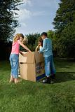 Children looking in cardboard box