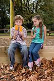 Boy and girl with ice lollies