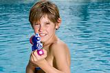 Boy with a water pistol