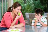 Mother and son eating apples