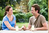 Couple sat in garden