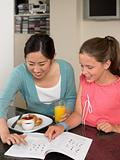 Exchange student and girl at breakfast